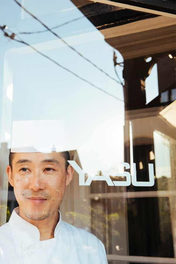 Chef looking out window at Yasu